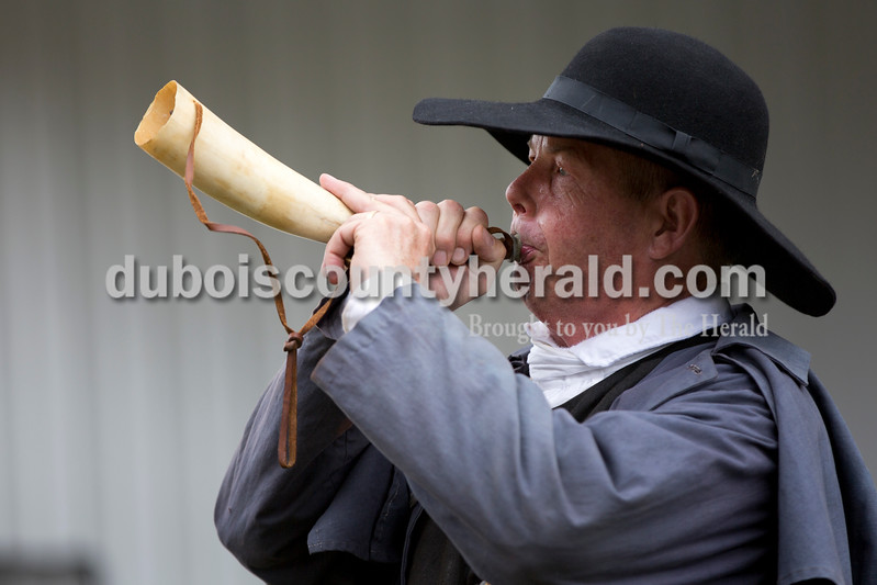 Sarah Shaw/The Herald<br /> Mike Mulligan of Waxhaw, N.C., blew a horn during a cowboy demonstration at the Cowboys for Christ event at Christ Community Fellowship Church in Huntingburg on Saturday.