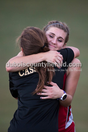 Southridge's Lauren Meyer hugged Jasper's Tara Cassidy during the awards ceremony after the Jasper Cross Country Invitational at Vincennes Lincoln Jasper Campus on Tuesday. Sarah Ann Jump/The Herald