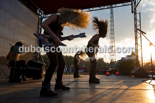 """Kaden Thyen of Duff, 11, Emily Ferguson of Huntingburg, 11, Kenley Ferguson of Huntingburg, 8, and Allyson Buening of Holland, 11, performed Metallica's """"Enter Sandman"""" during the Herbstfest Puttin' on the Hits lip-sync contest Saturday night at League Stadium. Their performance was complete with head banging, toy guitars, a makeshift drum set and live fireworks.   Alisha Jucevic/The Herald"""