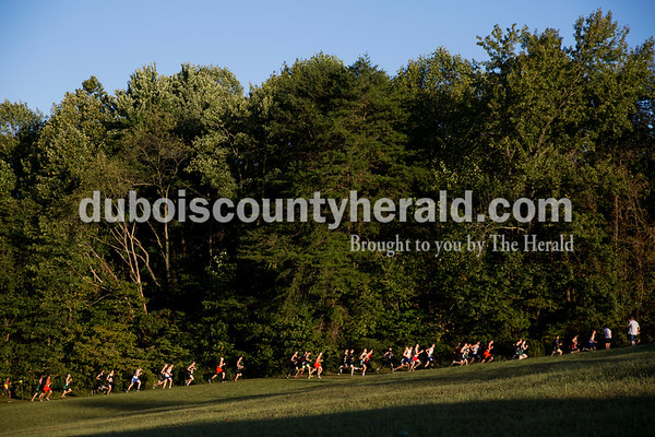 Varsity boys cross country runners raced during the Jasper Cross Country Invitational at Vincennes Lincoln Jasper Campus on Tuesday. Sarah Ann Jump/The Herald