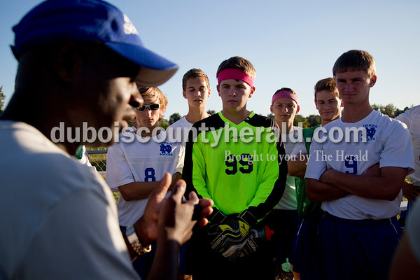Northeast Dubois' head coach Clive Williams spoke to the team before the start of the game against Heritage Hills in Dubois on Tuesday. Heritage Hills won 3-0.  Sarah Shaw/The Herald