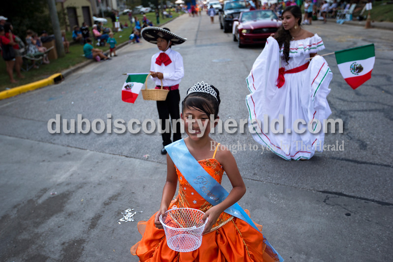 Little Miss Latino Festival  Lupita Sanchez of Dale, 10, walked with the Latino Festival pageant winners and the ALASI float, Association of Latin Americans in Southern Indiana, during the Herbstfest parade on Sunday afternoon in Huntingburg. <br /> Alisha Jucevic/The Herald