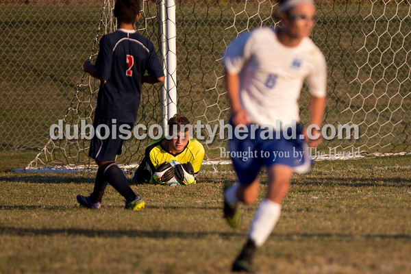 Northeast Dubois' Lucas Gutgsell made a save during the game against Heritage Hills in Dubois on Tuesday. Heritage Hills won 3-0.  Sarah Shaw/The Herald