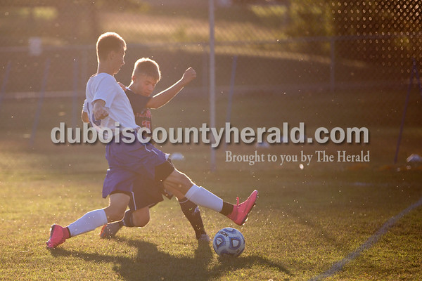 Northeast Dubois' Alan Kerstiens stole the ball from Heritage Hills' Austin Schnuck during the game in Dubois on Tuesday. Heritage Hills won 3-0.  Sarah Shaw/The Herald