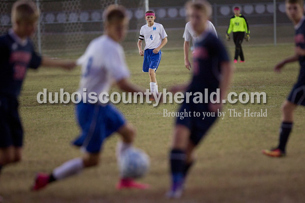 Northeast Dubois' Logan Dodd, center, watched as his teammate Alan Kerstiens fought to maintain possession during the game in Dubois on Tuesday. Heritage Hills won 3-0.  Sarah Shaw/The Herald