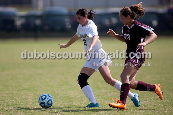 Sarah Shaw/The Herald Jasper's Annie Stout dribbled away from Gibson Southern's Katie Rose during the game in Jasper on Saturday. Jasper lost 4-2.