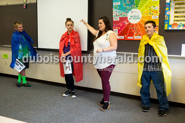 Sarah Ann Jump/The Herald Memorial Hospital counselor Jessica Miller, second from right, discussed how drugs and alcohol affected different decision-making parts of the brain, demonstrated by seventh-graders Nolan Winkler, left, Kristen Detty and Jace Schnarr during the Life Now program at Forest Park Middle School in Ferdinand on Friday.