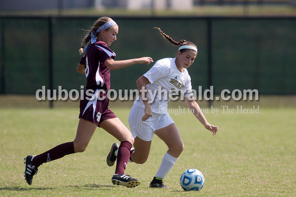 Sarah Shaw/The Herald Jasper's Summer Herzog and Gibson Southern's Abigail Goings fought for possession during the game in Jasper on Saturday. Jasper lost 4-2.