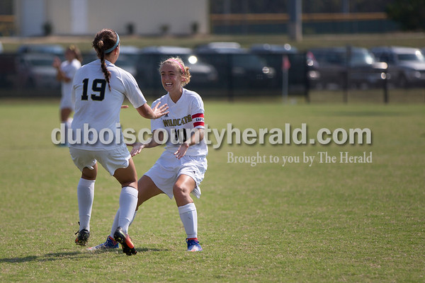 Sarah Shaw/The Herald Jasper's Hannah Love, left, celebrated with Anna Charron after scoring the first goal of the match against Gibson Southern in Jasper on Saturday. Jasper lost 4-2.