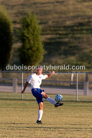 Northeast Dubois' Jacob Sanders cleared the ball during the game against Heritage Hills in Dubois on Tuesday. Heritage Hills won 3-0.  Sarah Shaw/The Herald