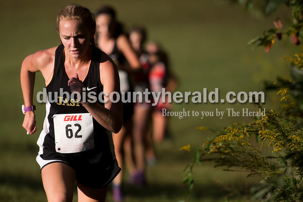Jasper's Noelle Weyer led a pack of runner up a hill during the Jasper Cross Country Invitational at Vincennes Lincoln Jasper Campus on Tuesday. Weyer placed seventh and the Jasper girls team placed first. Sarah Ann Jump/The Herald