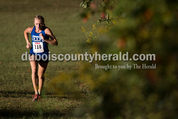 Northeast Dubois' Shelby Livingston ran during the Jasper Cross Country Invitational at Vincennes Lincoln Jasper Campus on Tuesday.  Livingston finished third. Sarah Ann Jump/The Herald