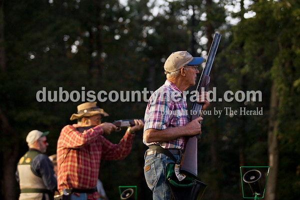 Linus Metz of St. Anthony, right, Leroy Betz of Celestine, center, and Tony Mann of Winslow, left,  took their turn to shoot during the fourth week of Jasper Rifle and Gun Club's fall trap league on Tuesday evening in Jasper.   Alisha Jucevic/The Herald