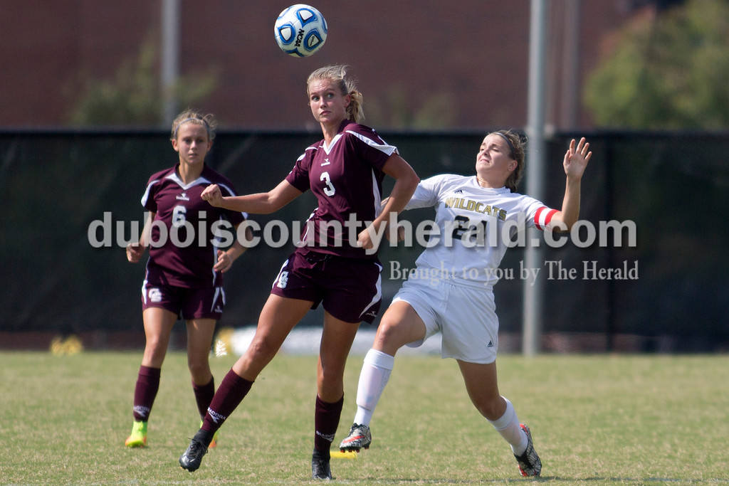 Sarah Shaw/The Herald<br /> Gibson Southern's Grace Bammer kept her eye on the ball while fighting for position with Jasper's Reagan Otto during the game in Jasper on Saturday. Jasper lost 4-2.