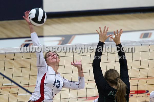 Heritage Hills' Kasey Schaeffer spiked the ball as Forest Park's Taylor Bayer jumped to block during Monday night's game in Lincoln City. The Patriots won 25-11, 25-13, 25-8.  Alisha Jucevic/The Herald
