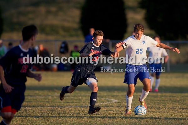 Heritage Hills' Carson Leibering chased Northeast Dubois' Chase Reckelhoff during the game in Dubois on Tuesday. Heritage Hills won 3-0.  Sarah Shaw/The Herald