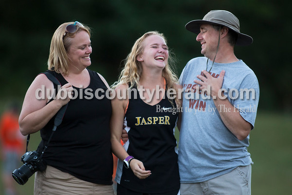 Jasper senior Noelle Weyer shared a moment with her parents Holly and Moose Weyer of Jasper during the senior night ceremony after the Jasper Cross Country Invitational at Vincennes Lincoln Jasper Campus on Tuesday. Sarah Ann Jump/The Herald