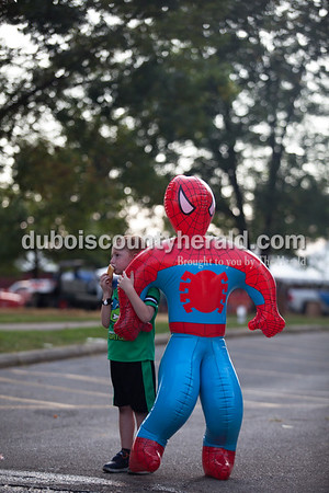 """Andrew Curtis of Huntingburg, 5, stood will his new Spiderman toy as he waited for his mother, Haley, during Herbstfest on Saturday in Huntingburg.  Haley said Andrew just told her what it means when Spiderman's arm is around him. """"It means we're best buddies,"""" he said.  Alisha Jucevic/The Herald"""