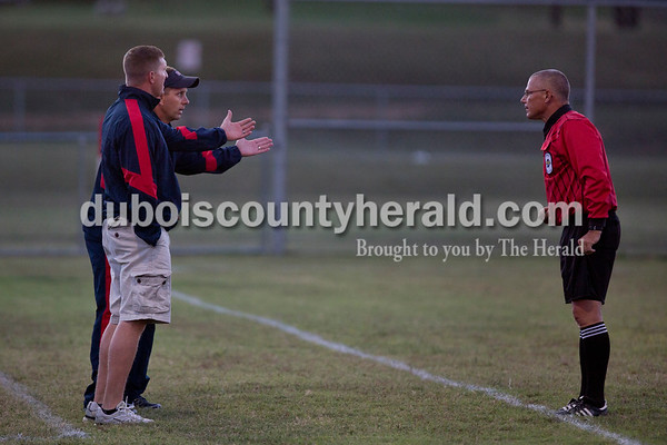Heritage Hills assistant coach Andy Fischer and head coach Joe Asbury argued with the referee after Asbury was given a yellow card during the game in Dubois on Tuesday. Heritage Hills won 3-0.  Sarah Shaw/The Herald