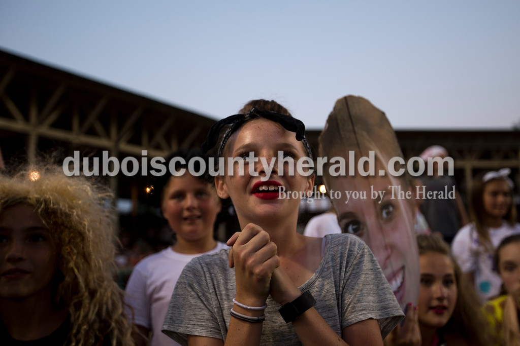Blair Tretter of Huntingburg, 11, watched Puttin' on the Hits event organizers Emily Meyer and Elizabeth Wertman during their lip-sync battle onstage at Herbstfest on Saturday in Huntingburg. <br /> Alisha Jucevic/The Herald