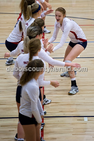 Heritage Hills' Jessica Bertke high-fived her teammates during introductions before Monday night's game against Forest Park in Lincoln City. The Patriots won 25-11, 25-13, 25-8.  Alisha Jucevic/The Herald