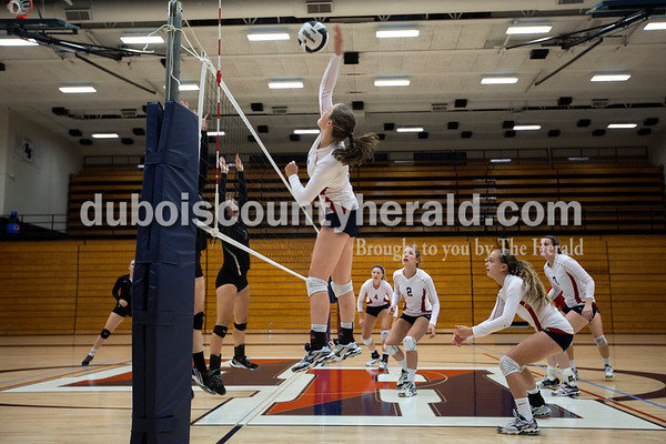 Heritage Hills' Abby Wahl spiked the ball during Monday night's game against Forest Park in Lincoln City. The Patriots won 25-11, 25-13, 25-8.  Alisha Jucevic/The Herald