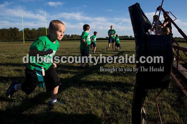Sarah Ann Jump/The Herald Brayden Wilz of Holland, 6, ran towards the sled during Southridge Raider flag football at the school in Huntingburg on Monday.