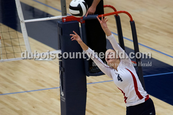 Heritage Hills' Abby Wetzel set the ball during Monday night's game against Forest Park in Lincoln City. The Patriots won 25-11, 25-13, 25-8.  Alisha Jucevic/The Herald
