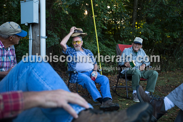 Don Mann of Winslow, center, chatted with Linus Metz of St. Anthony, left, and Jim Warnsman of Huntingburg, right, as they waited for their turn to shoot during the fourth week of Jasper Rifle and Gun Club's fall trap league on Tuesday evening in Jasper.  Mann, Metz, Warnsman and their other teammate Leroy Betz have been shooting together for at least ten years. They say it's not just about the shooting, but also the friendship and time to catch up with one another. At age 84, Warnsman is the oldest member of the league this year, and Daniel Moore of Jasper, 12, is the youngest.   Alisha Jucevic/The Herald