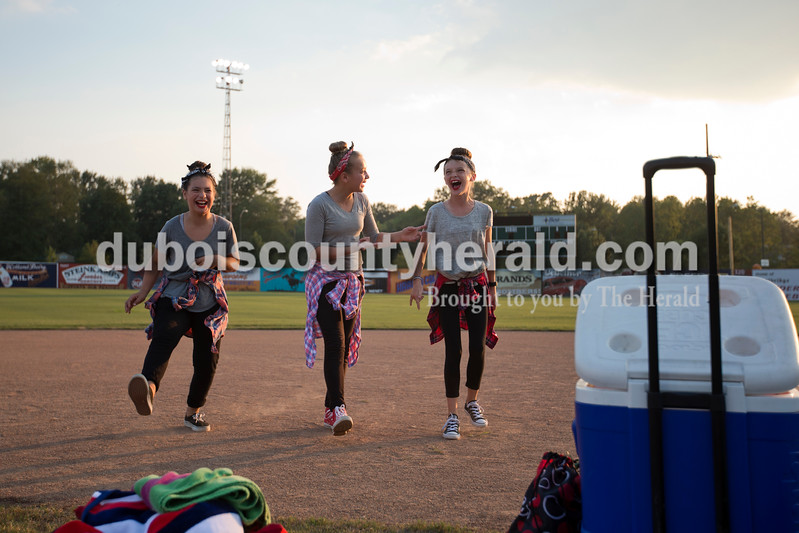 Gabrielle McDowell, 11, left, Arrington Hartke , 11, and Blair Tretter, 11, all of Huntingburg, practiced their dance behind the stage during the Puttin' On the Hits lip-sync competition at Herbstfest on Saturday in Huntingburg. <br /> Alisha Jucevic/The Herald