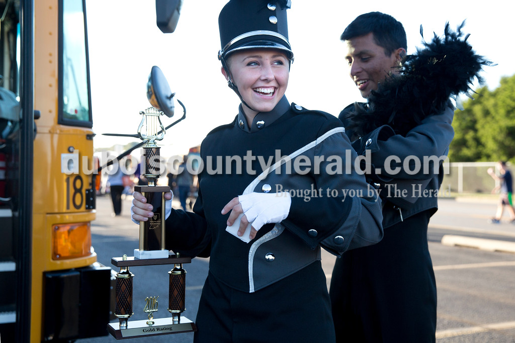 Southridge senior Marco Rocha unzipped the uniform of Katelyn Neukam, both drum majors, during Saturday's ISSMA Marching Band Scholastic Prelims and Open Class Invitational at Jerry Brewer Alumni Stadium in Jasper. Sarah Ann Jump/The Herald