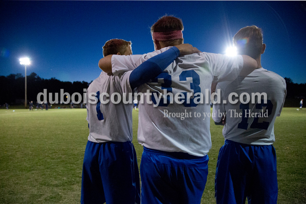 Northeast Dubois' Jacob Sander, Blake Ziegler, and Robert Reutman wrapped their arms around each other before the start of the Class 1A sectional championship game against Heritage Hills in Lincoln City on Saturday. Heritage Hills won 5-3. <br /> Sarah Shaw/The Herald