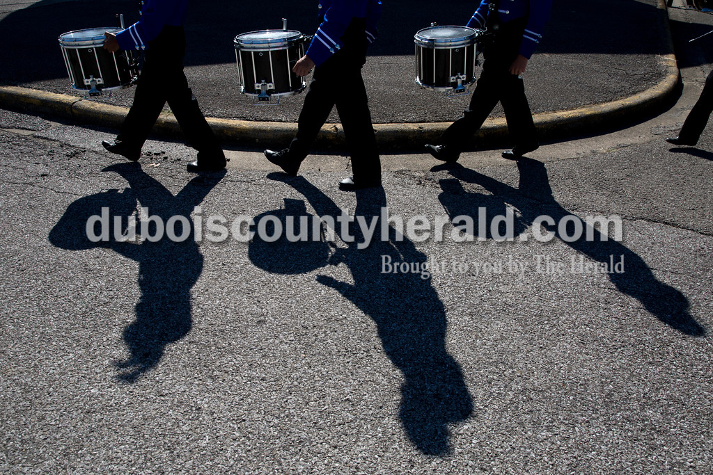 Northeast Dubois drummers junior Leslie Mora, left, sophomore Dayton Cummins and eight-grader Jackson Harrison walked to their performance during Saturday's ISSMA Marching Band Scholastic Prelims and Open Class Invitational at Jerry Brewer Alumni Stadium in Jasper. Sarah Ann Jump/The Herald