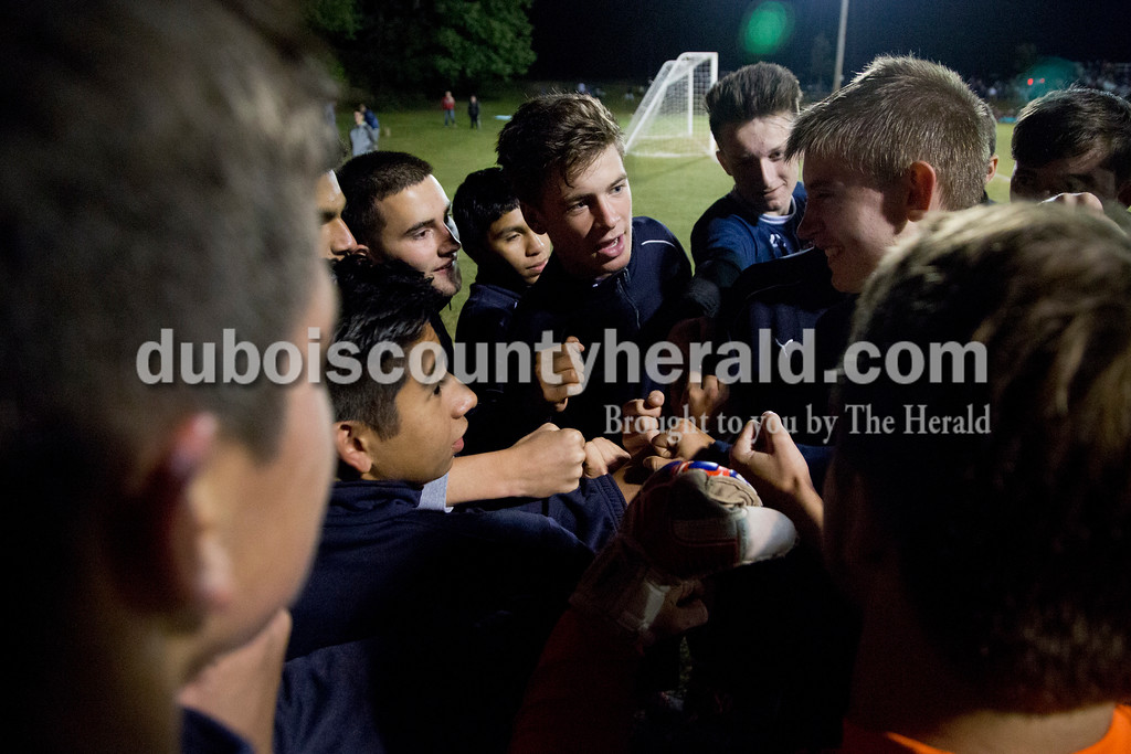 The Heritage Hills' boys soccer team huddled before the start of the second half of the Class 1A sectional championship game against Northeast Dubois in Lincoln City on Saturday. Heritage Hills won 5-3. <br /> Sarah Shaw/The Herald