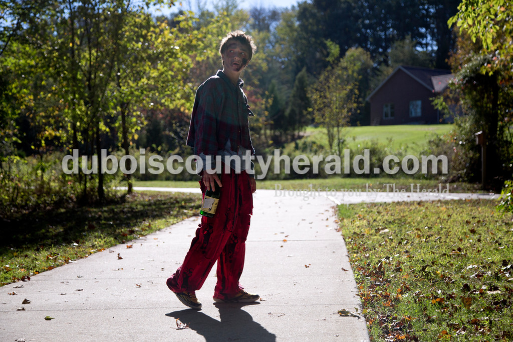Sarah Shaw/The Herald<br /> Dressed like a zombie, Tanner Kane of Huntingburg, 14, waited for runners to cross his path during the Haunted Huntingburg Zombie 5K at Niehaus Park in Huntingburg on Saturday.