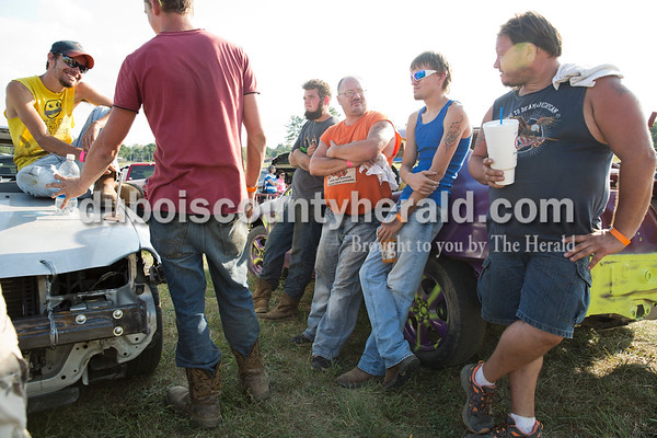Collin Kerstiens of Santa Claus, left, Cody Wolf of Dale, Tyler Weedman of Newtonville, Tim Ubelhor of Gentryville, Shawn Ubelhor of Gentryville and Greg Ubelhor of Ferdinand chatted before the demolition derby in Boonville on Sept. 4. Derby drivers must check in and have their cars inspected hours before the event, so they spend the remaining time socializing.