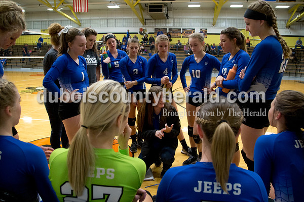 Sarah Shaw/The Herald Northeast Dubois head coach Kendra Kopatich spoke with the team before the start of the second set during Thursday's Class 1A sectional semifinal against Cannelton in French Lick. Northeast Dubois won 3-0.