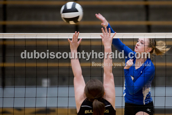 Sarah Shaw/The Herald Northeast Dubois' Adi Denu attempted a kill shot while Cannelton's April Terry defended during Thursday's Class 1A sectional semifinal against Cannelton in French Lick. Northeast Dubois won 3-0.