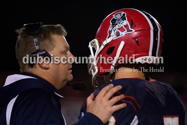 Heritage Hills coach Todd Wilkerson spoke to Cade Jones during Friday's 3A sectional football game in Lincoln City. Southridge defeated Heritage Hills 37-34 in double overtime. Sarah Ann Jump/The Herald