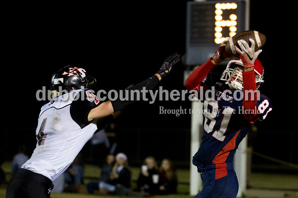 Heritage Hills' Gabe Hitz caught a touch down pass as Southridge's Nolan O'Brien defended during Friday's 3A sectional football game in Lincoln City. Southridge defeated Heritage Hills 37-34 in double overtime. Sarah Ann Jump/The Herald