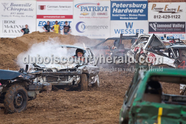 Greg Ubelhor of Ferdinand drove his smoking car in the demolition derby in Boonville on Sept. 4. His car caught on fire twice during the event.