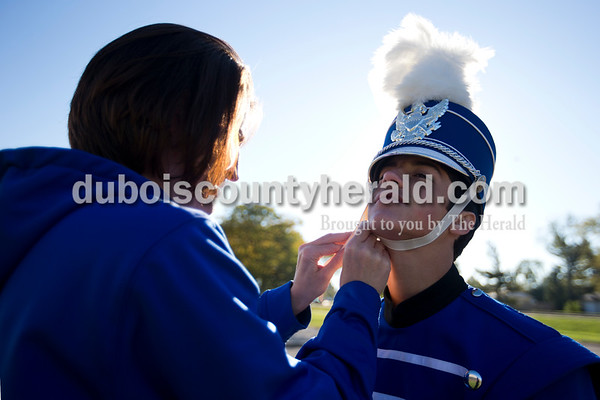 Northeast Dubois color guard coach Shannelle Kline fixed sophomore Jacob Lutes' hat before physical warmups during Saturday's ISSMA Marching Band Scholastic Class state finals at Lawrence Central High School in Indianapolis.   Alisha Jucevic/The Herald