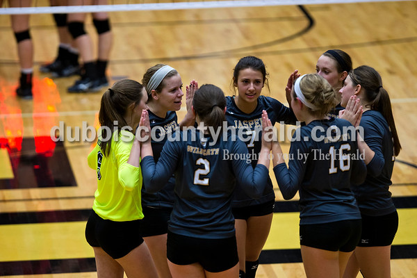 The Wildcats huddled together before the first round of the Class 3A sectional against Princeton on Thursday night at Jasper High School. Jasper swept Princeton 25-19, 25-19, 25-16.    Alisha Jucevic/The Herald