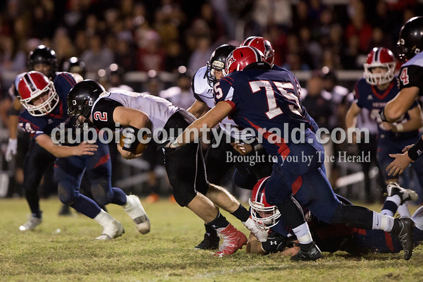 Southridge's Jayce Harter was brought down by Heritage Hills' defense during Friday's 3A sectional football game in Lincoln City. Southridge defeated Heritage Hills 37-34 in double overtime. Sarah Ann Jump/The Herald