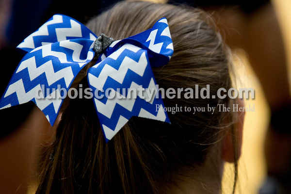Sarah Shaw/The Herald Northeast Dubois' Carly Terwiske wore a blue and white bow in her hair during Thursday's Class 1A sectional semifinal against Cannelton in French Lick. Northeast Dubois won 3-0.
