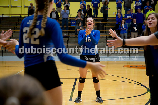 Sarah Shaw/The Herald Northeast Dubois' Megan Lueken, right, cheered as Alex Dodson was introduced before the start of Thursday's Class 1A sectional semifinal against Cannelton in French Lick. Northeast Dubois won 3-0.