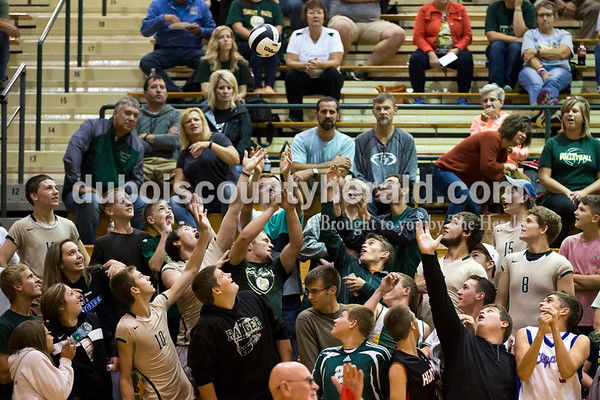Forest Park fans reached to catch an out-of-bounds ball during Thursday's 2A sectional volleyball game in Ferdinand. Tell City defeated Forest Park 3-1. Sarah Ann Jump/The Herald