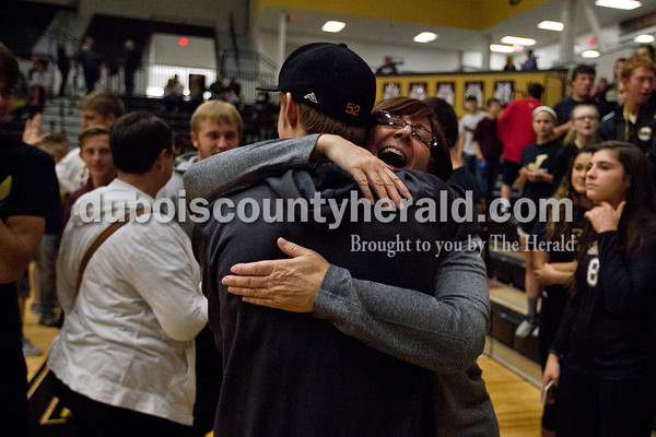 Jasper High School sophomore Reece Milligan hugged his mother and head coach Liz Milligan after Jasper swept Princeton 25-19, 25-19, 25-16 in Thursday night's Class 3A volleyball sectional in Jasper.    Alisha Jucevic/The Herald