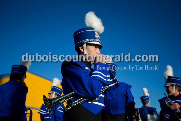 Northeast Dubois seventh-grader Brice Priddy blew warm air into his mouth piece to warm it up before Saturday's ISSMA Marching Band Scholastic Class state finals at Lawrence Central High School in Indianapolis. This was the first time the band played in the finals of an ISSMA competition.  Alisha Jucevic/The Herald