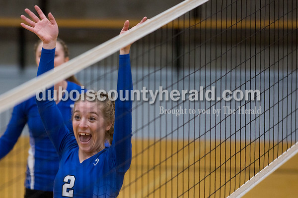 Sarah Shaw/The Herald Northeast Dubois' Clare Mangin celebrated a point during Thursday's Class 1A sectional semifinal against Cannelton in French Lick. Northeast Dubois won 3-0.
